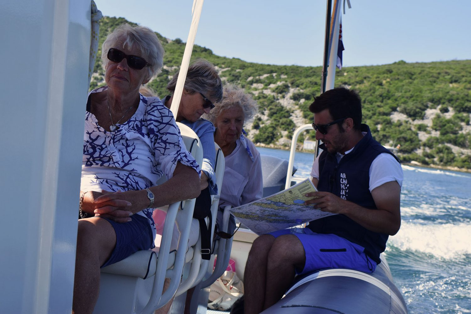 Archipelago Tours Krka Experience Private tour - Krka Experience Private Tour photo of the tour guide conversating with the tourists during a boat tour
