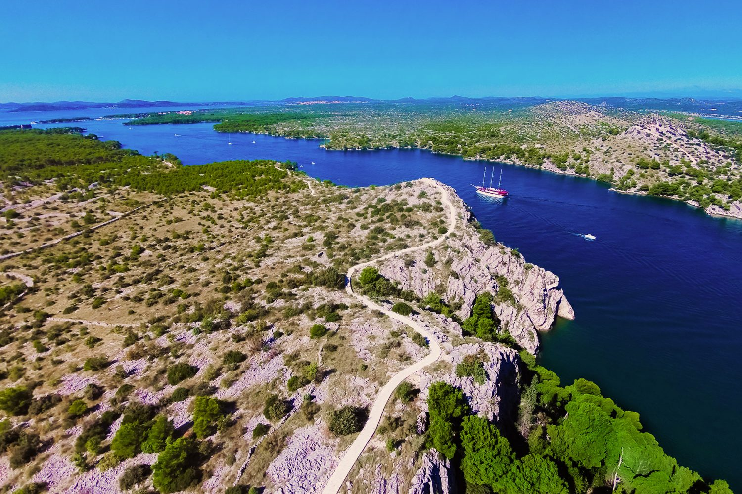 Archipelago Tours Krka Private Boat tour - Krka Channel Cruise Private Boat Tour photo of St Anthony Channel with St Nicholas fortress i the background