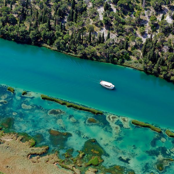 Archipelago Tours - Krka Experience Private Tour photo of a boat on river Krka in Krka National Park taken from the air