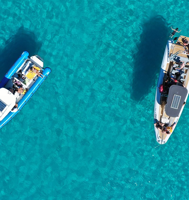Archipelago Tours - Exclusive Charter photo taken from the air capturing two boats floating on the turquoise sea at Lojena beach in Kornati national park