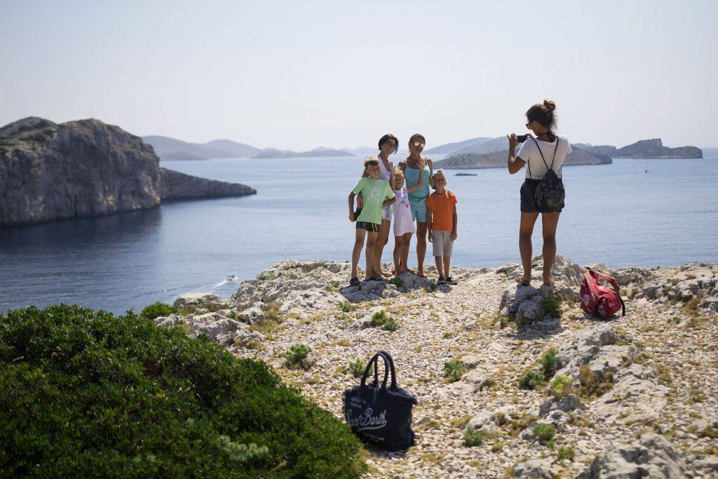 Archipelago Tours Kornati Experience Small Group Tour photo of the tourists on top of Mana island with a view of Kornati archipelago in the background