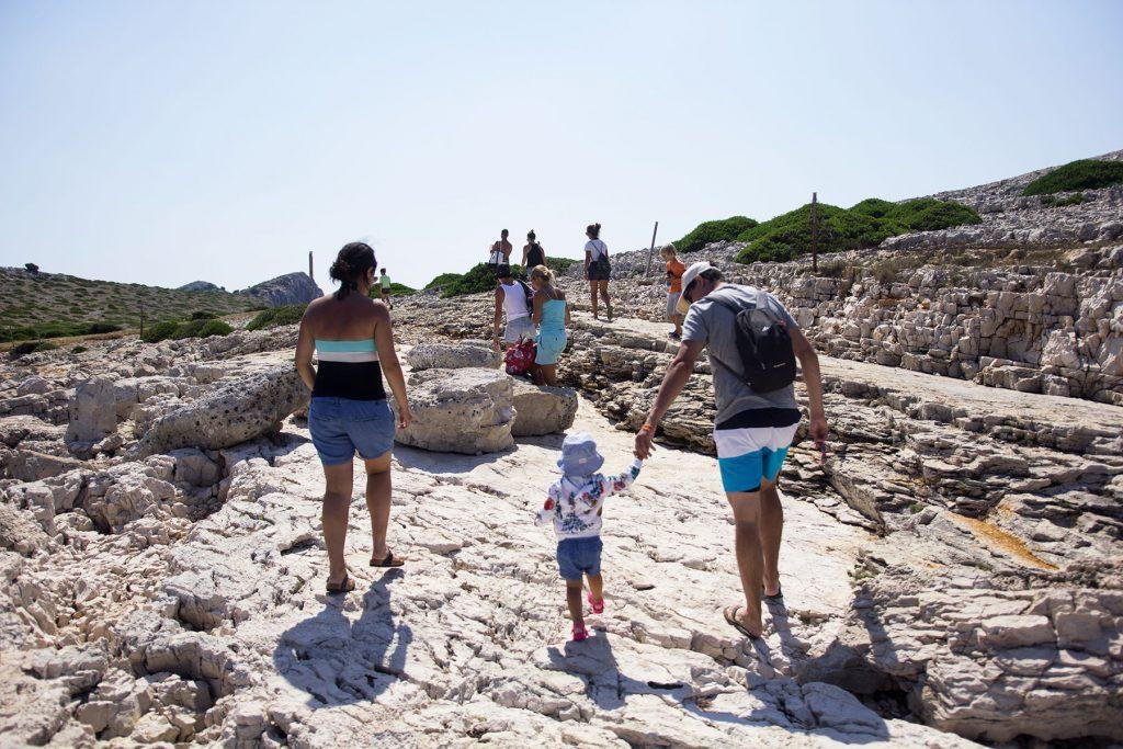 Archipelago Tours Kornati Experience Small Group Tour photo of tourist taking a walk on ;Mana island in Mornati national Park