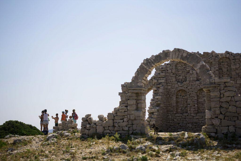 Archipelago Tours Kornati Experience Small Group Tour photo of tourists next to the ruins of an old movie set on Mana island on Kornati national park