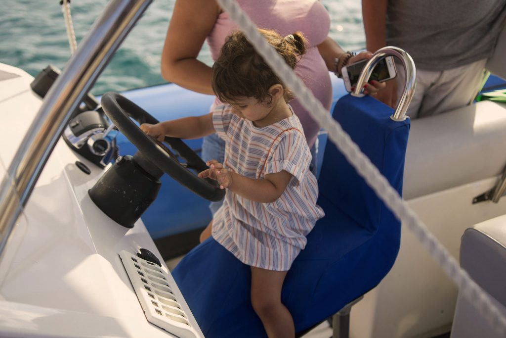 Archipelago Tours Kornati Experience Small Group Tour photo of a baby girl on the boat