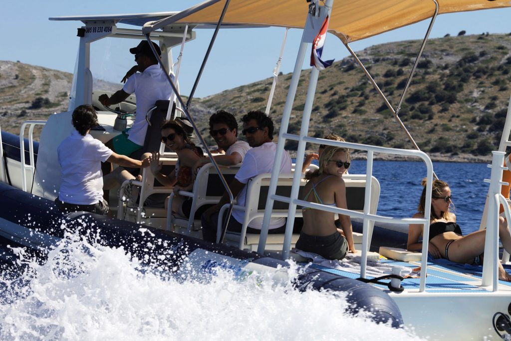Archipelago Tours Kornati Experience Small Group Tour photo of tourist enjoying a ride on the boat