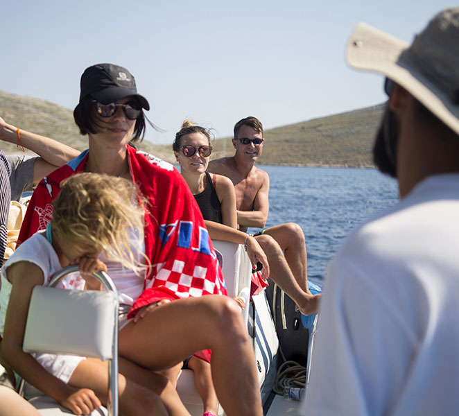 Archipelago Tours Speedboat tours from Sibenik - About us photo Archipelago Tours Speedboat tours from Sibenik - About us photo of tourists listening to guide's presentation