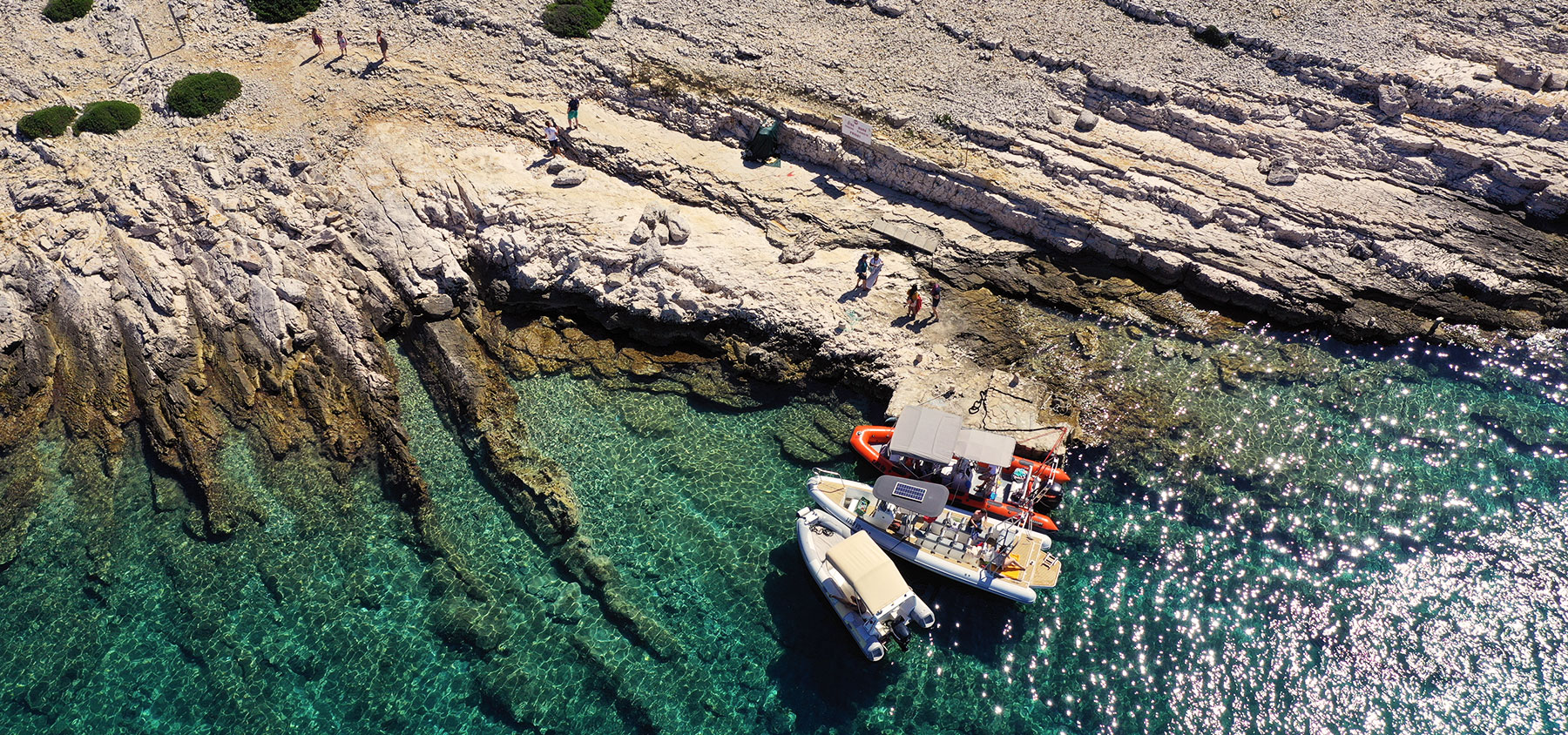 Aerial photo of the boat and tourists taken in Kornati