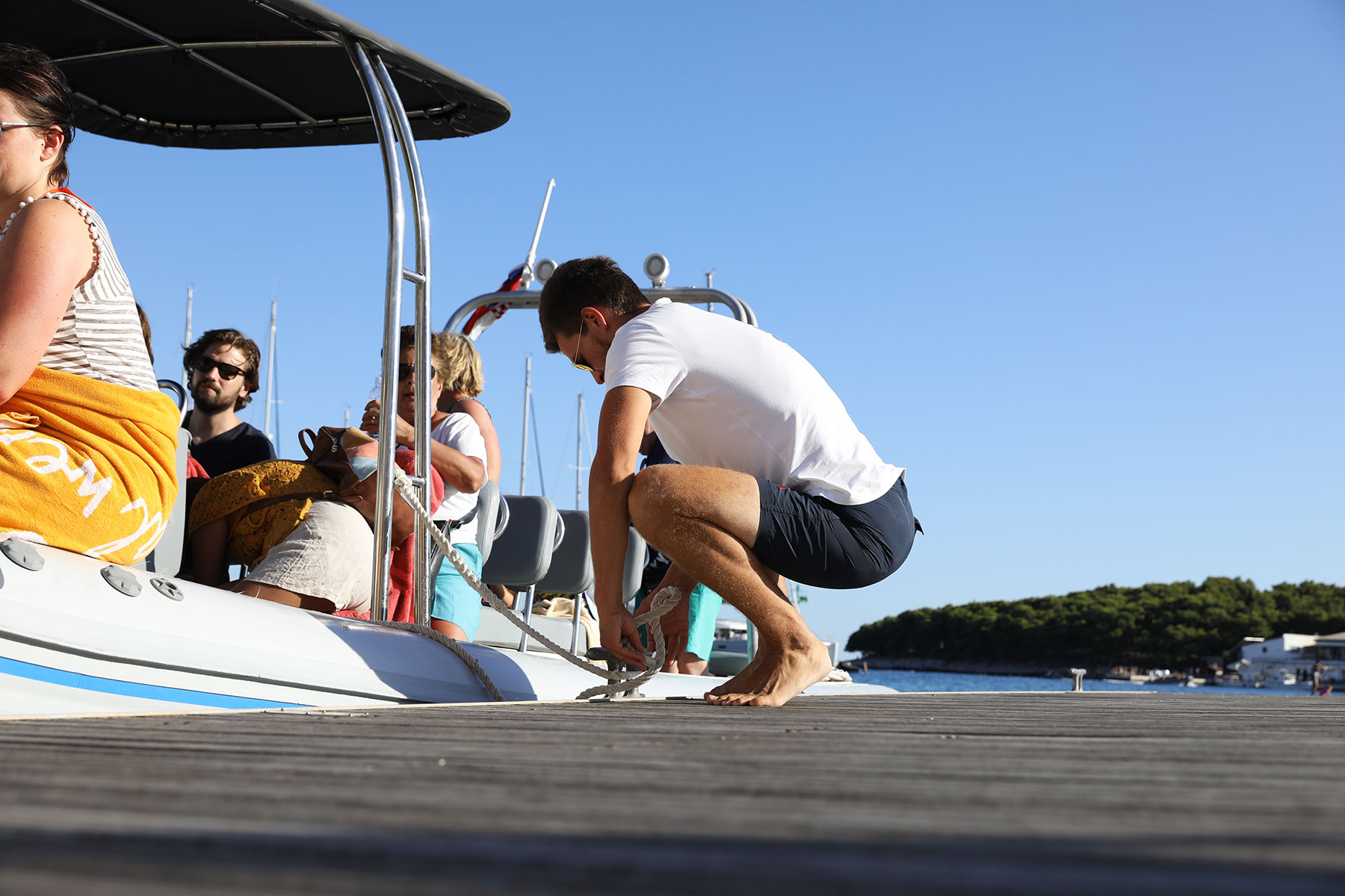Work with Archipelago Tours as boat tour guides - photo of our skipper mooring the boat